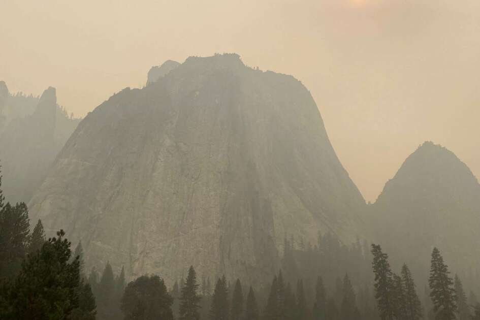 Cathedral Rocks, shrouded in smoke, in Yosemite National Park.