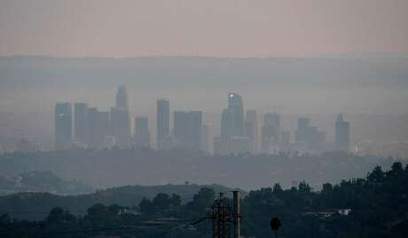 The downtown Los Angeles skyline is shrouded in haze on September 16, 2020 from recent and ongoing West Coast fires now showing a global smoke path blowing thousands of miles east. - California faces more devastation from wildfires that have ravaged the West Coast, authorities warned on September 16, with strong winds and dry heat expected to whip up flames from dozens of blazes raging across the state. (Photo by Frederic J. BROWN / AFP) (Photo by FREDERIC J. BROWN/AFP via Getty Images)