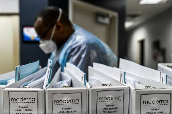 (FILES) In this file photo taken on August 13, 2020, Biotechnology company Moderna protocol files for Covid-19 vaccinations are kept at the Research Centers of America in Hollywood, Florida. - Moderna, one of two companies currently holding phase 3 trials in the US for a Covid-19 vaccine, took the unusual step on September 17, 2020, of publishing its trial protocols after calls for more transparency. (Photo by CHANDAN KHANNA / AFP) (Photo by CHANDAN KHANNA/AFP via Getty Images)