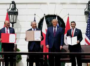 Bahrain Foreign Minister Khalid bin Ahmed Al Khalifa, from left, President Donald Trump, Israeli Prime Minister Benjamin Netanyahu and United Arab Emirates Foreign Minister Abdullah bin Zayed al-Nahyan, attend a signing ceremony that wasn't supposed to happen.