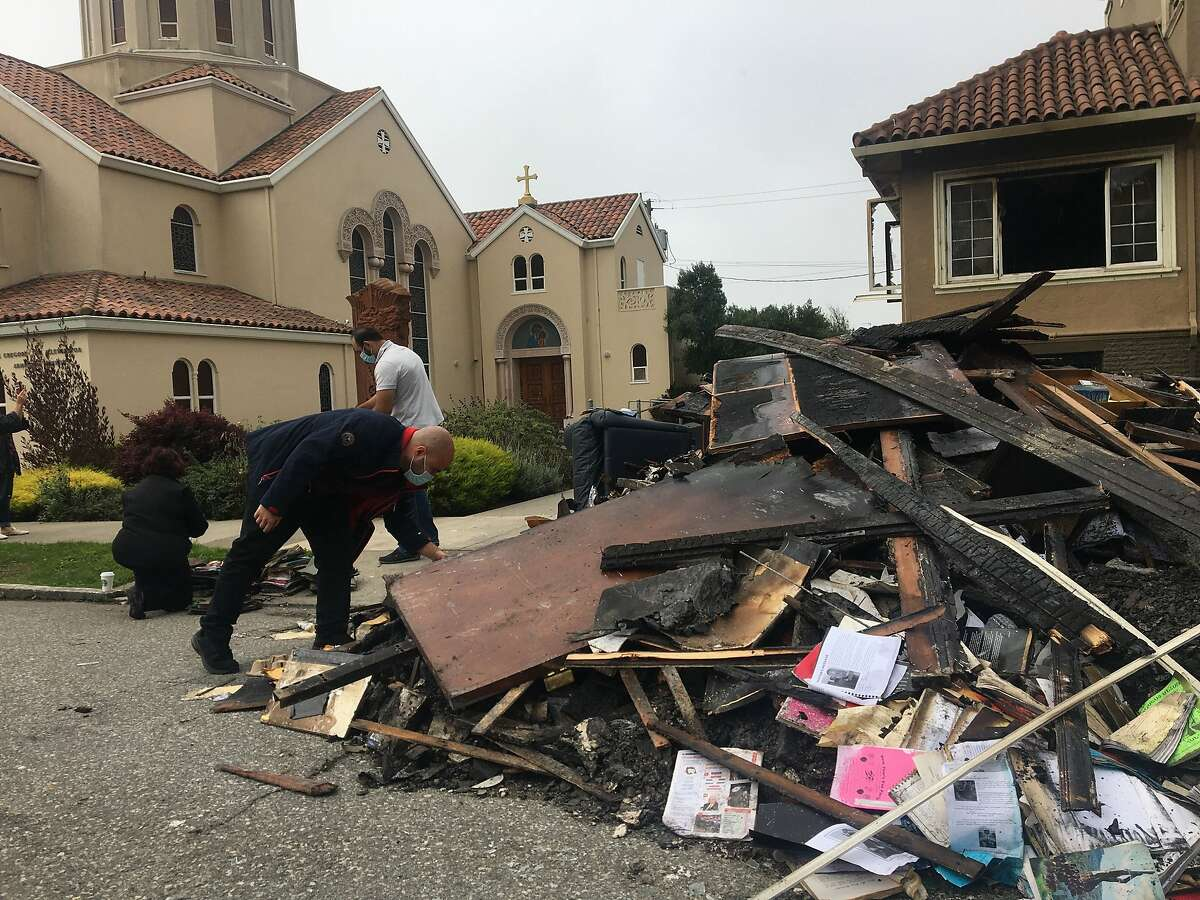 Parishoners at St. Gregory Armenian Apostolic Church clear out charred remains of their church, which burned overnight or early Thursday. Church members are deeply troubled, since the fire follows the tagging of an Armenian school with hateful graffiti in July.