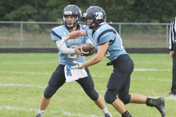 Brethren quarterback Skylar Wojciechowski (left) will look to lead the Bobcats this season during his senior year. (News Advocate file photo)