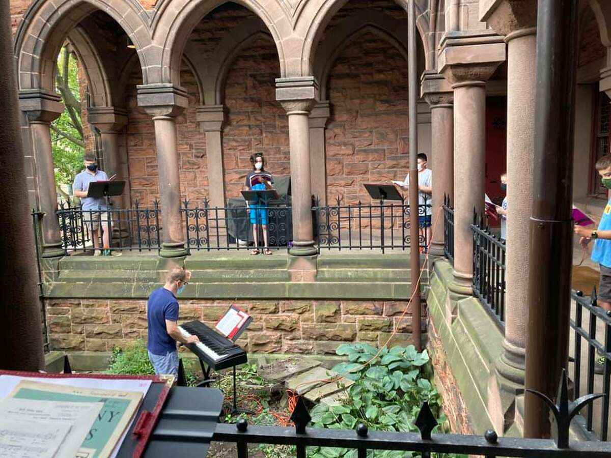 Young men from Albany's Cathedral Of All Saints' choir rehearsed safely following all necessary health protocols in the cloisters Wednesday evening.