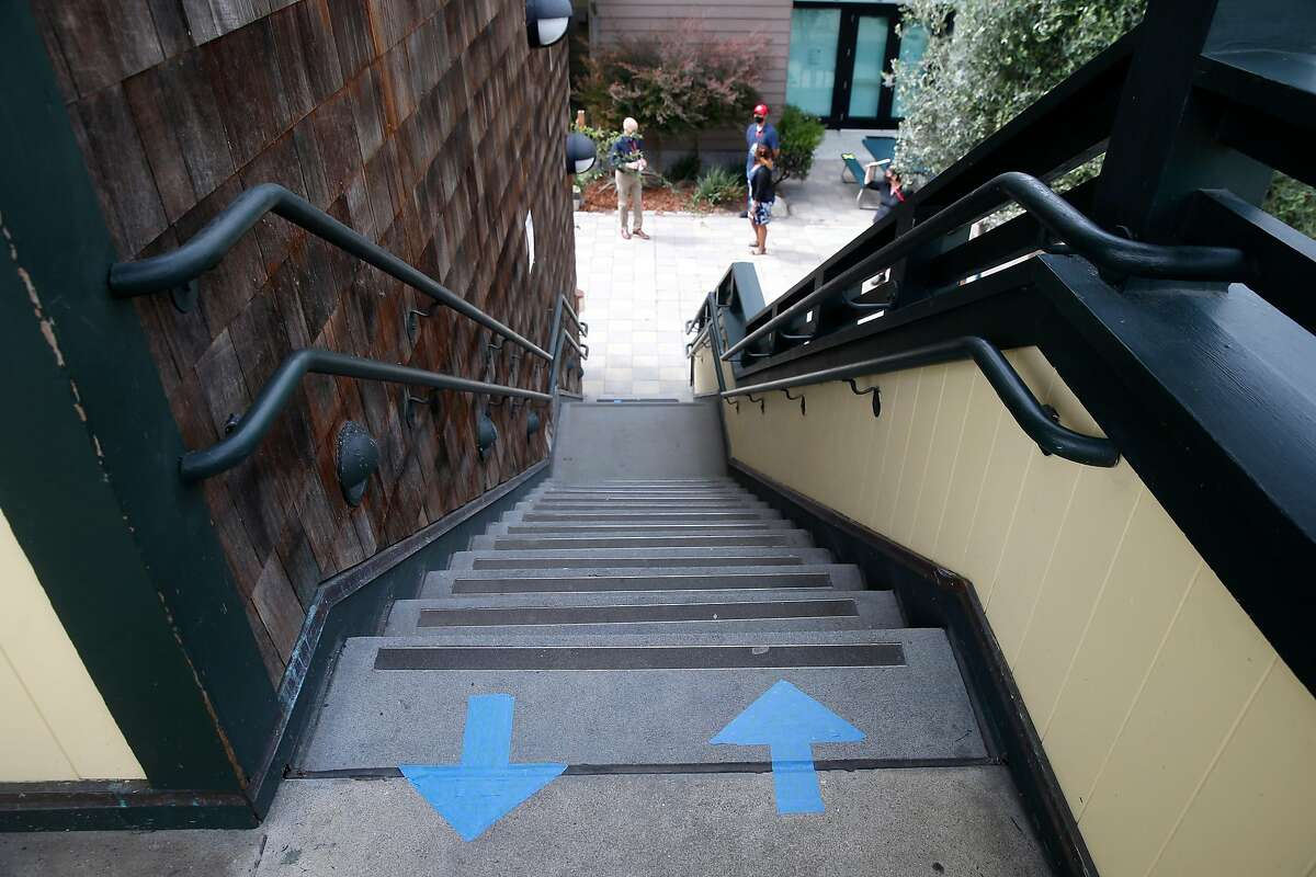 Stairs are marked with directional arrows. City officials conduct an inspection of The San Francisco School before authorizing in-person learning on the campus in San Francisco, Calif. on Thursday, Sept. 17, 2020. The private school with 285 students enrolled is among the first school's in the city to apply for in-classroom instruction.