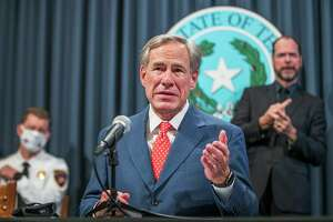 Texas Gov. Greg Abbott said Thursday, Sept.17, 2020 during a press conference that he would allow businesses to expand capacity in much of the state, citing a decline in coronavirus hospitalizations. The order allows businesses operating at 50% capacity to move to 75% starting Monday. That includes restaurants, retail, office buildings, manufacturing, gyms, libraries and museums. Bars remain closed under the order. [RICARDO B. BRAZZIELL/AMERICAN-STATESMAN]