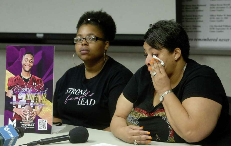 Toneenya Green wipes her eyes while talking about the death of her son Cifford Earl Jones, Jr., while daughter Taneace Jones holds a picture of her brother as family and friends gather at the Beaumont Police Department to share their memories of Jones and ask the community for help in solving his homicide. Jones was shot and killed at the Jefferson House Apartments in Beaumont July 11. Family and detectives are urging those with any information to call Crime Stoppers. Photo taken Thursday, September 17, 2020 Kim Brent/The Enterprise Photo: Kim Brent / The Enterprise / BEN