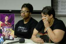 Toneenya Green wipes her eyes while talking about the death of her son Cifford Earl Jones, Jr., while daughter Taneace Jones holds a picture of her brother as family and friends gather at the Beaumont Police Department to share their memories of Jones and ask the community for help in solving his homicide. Jones was shot and killed at the Jefferson House Apartments in Beaumont July 11. Family and detectives are urging those with any information to call Crime Stoppers. Photo taken Thursday, September 17, 2020 Kim Brent/The Enterprise