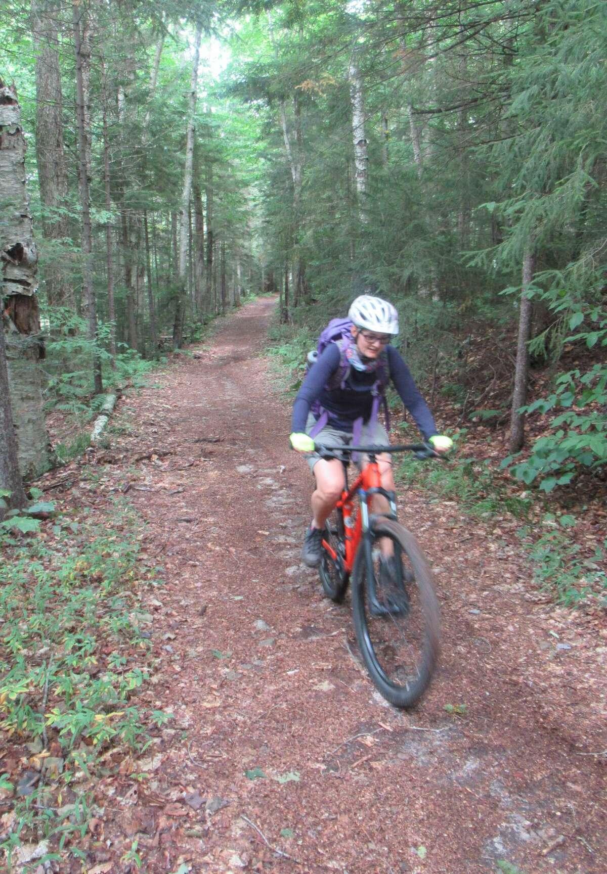 Outdoor writer Gillian Scott rides a doubletrack mountain bike trail near Inlet. (Herb Terns / Times Union)