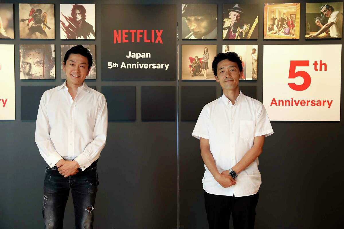 In this photo released by Netflix, Kaata Sakamoto, left, director of its content acquisition, and filmmaker Shinsuke Sato attend a livestream held from the Netflix Tokyo office on Sept. 7, 2020. After five years in Japan, Netflix now has 5 million households that have signed with the video-streaming service. The coronavirus pandemic, which has people staying home, has helped. But that number is still a fraction of Netflix's 193 million global paid members, and just 10% of Japan, where old-fashioned TV remains popular. Sato directs a live-action adaptation of cult manga, a€œAlice in Borderlanda€ for Netflix. (Netflix via AP)