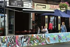 Diners eat at Public Wine Bar along Washington Street in Norwalk on Thursday.