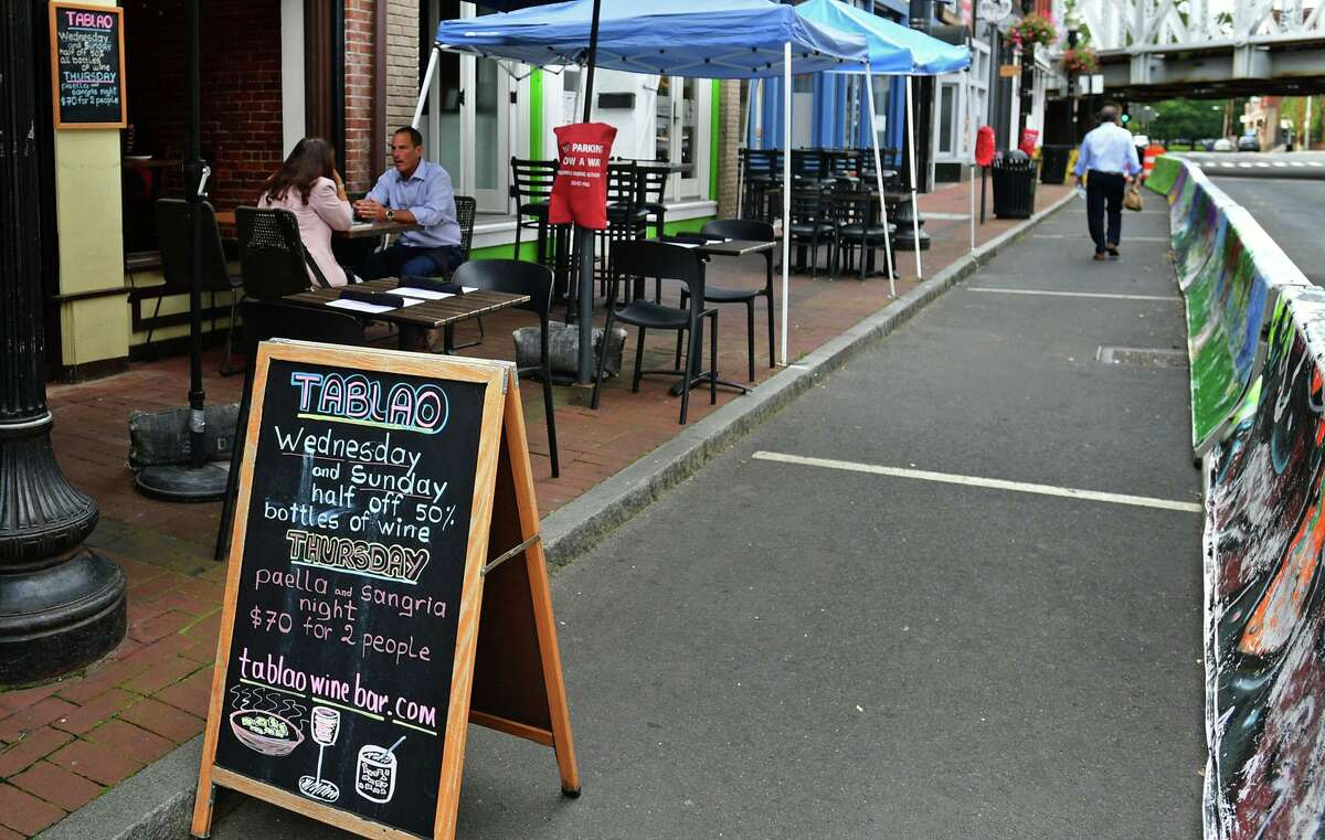 Diners along Washington Street in Norwalk, Conn., in mid-September 2020. As of Oct. 8, restaurants were allowed to increase their indoor seating capacity by half, possibly spurring more hiring heading into the fall.