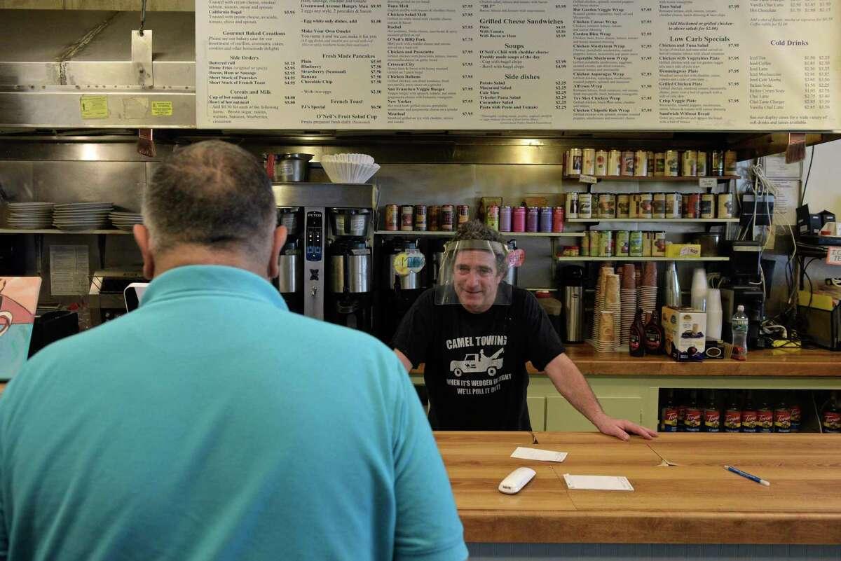 P.J. O'Neil, owner of O'Neil's Sandwich & Coffee Bar, talks with a customer on Thursday.