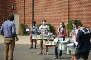 An outdoor band practice at Daniel Hand High School in Madison, Conn. on Sep. 17, 2020, as the school district returns to a hybrid model during the COVID-19 pandemic.