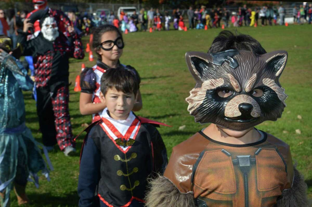 Second grader Ameer Hussein walks with his class during the Brookside Elementary School annual schoolwide Halloween Parade Wednesday, October 31, 2018, at the school in Norwalk, Conn.