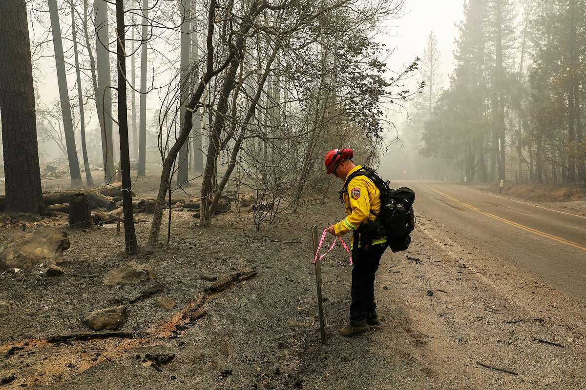 Fire captain Chase Beckman does damage inspection after the North Complex fire tore through the Berry Creek area on Sunday, Sept. 13, 2020 in Butte County, California.
