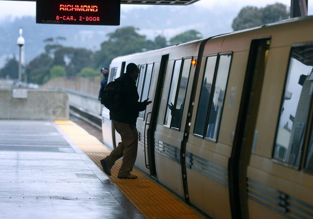A passenger boards a Richmond train at the MacArthur BART station in Oakland, Calif. on Tuesday, May 12, 2020. BART is joining transit agencies from around the country in seeking economic federal relief funds because of dwindling ridership during the coronavirus shutdown.