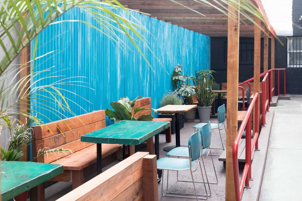 The outdoor patio space at Kingston 11 Cuisine in Oakland's Uptown neighborhood.