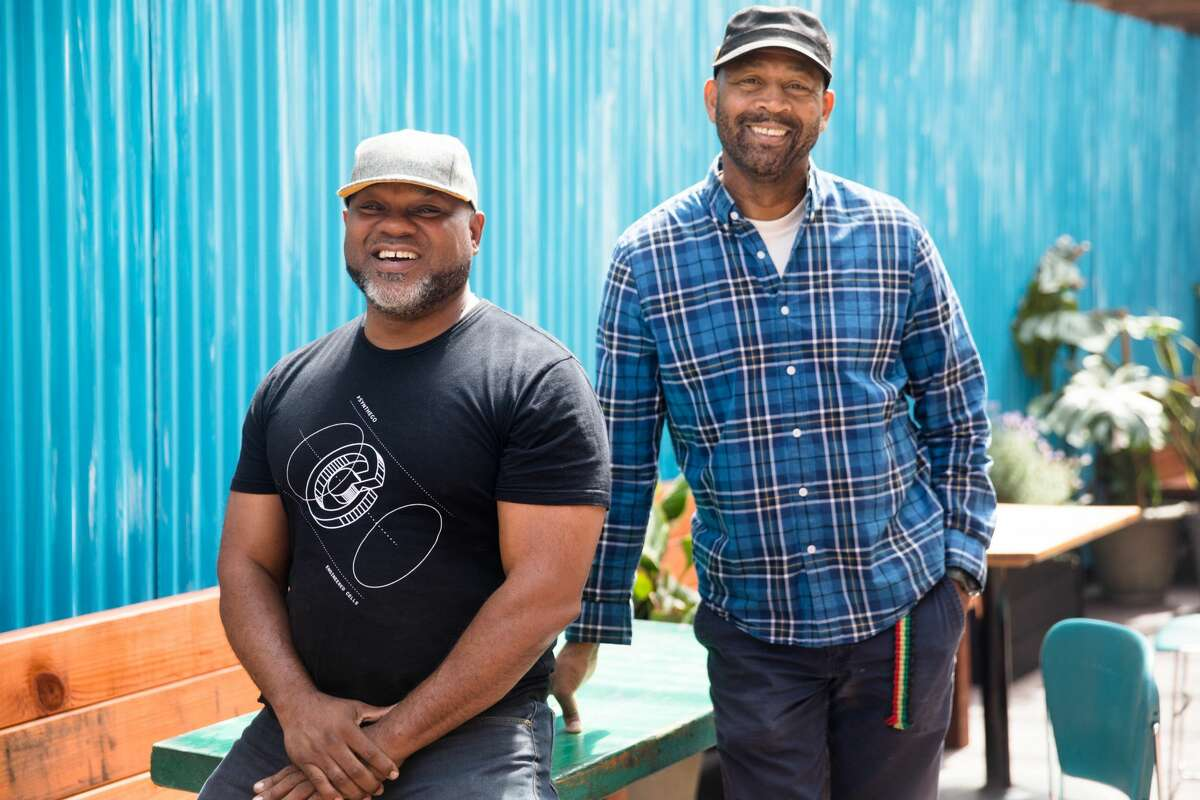 (Left to right) Adrian Henderson and his business partner Nigel Jones run Kingston 11 Cuisine, which features Jamaican food. They are opening an outdoor patio space behind their restaurant in Oakland's Uptown neighborhood.