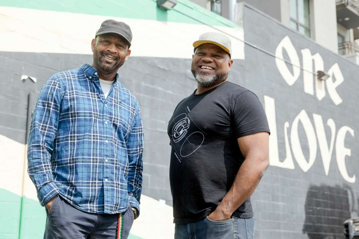 (Left to right) Nigel Jones and his business partner Adrian Henderson run Kingston 11 Cuisine, which features Jamaican food. They are opening an outdoor patio space behind their restaurant in Oakland's Uptown neighborhood.