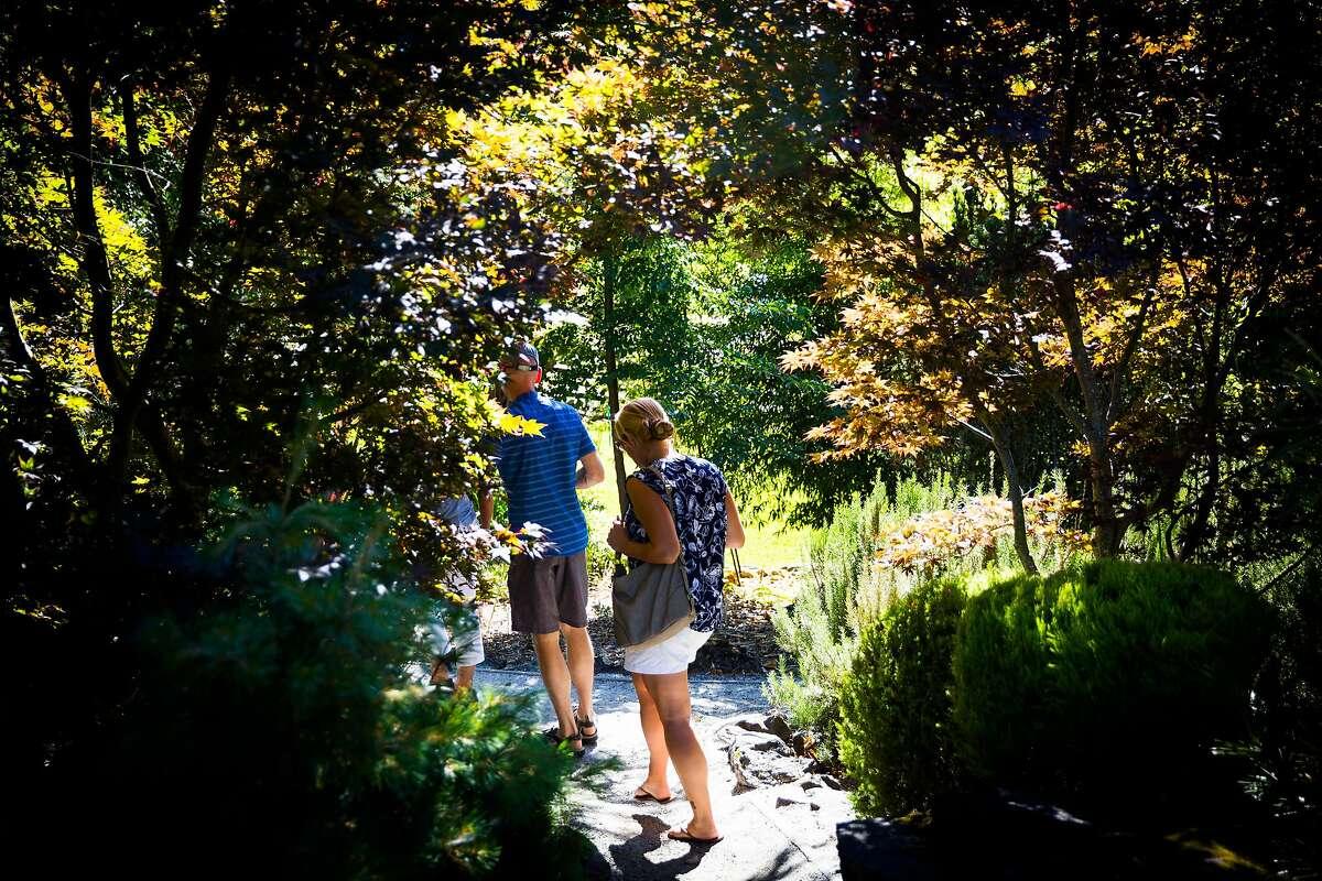 Walking through the garden at Arista Winery in Healdsburg, California on June 27, 2017.