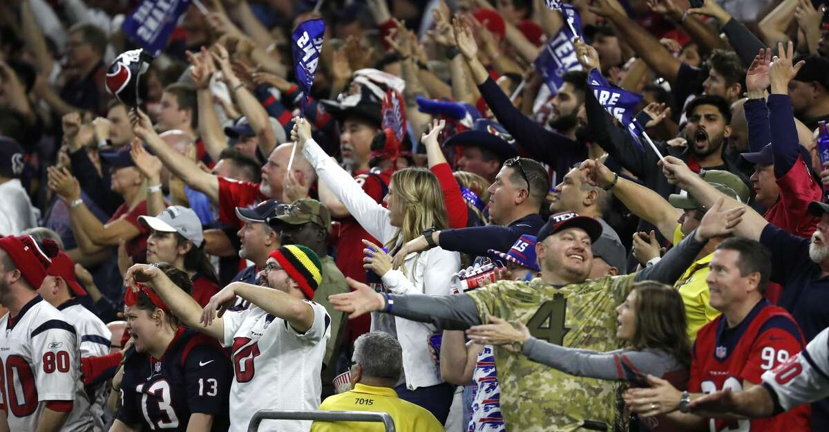 Houston Texans fans cheer during the fourth quarter of an AFC wild card playoff game at NRG Stadium on Saturday, Jan. 4, 2020, in Houston.