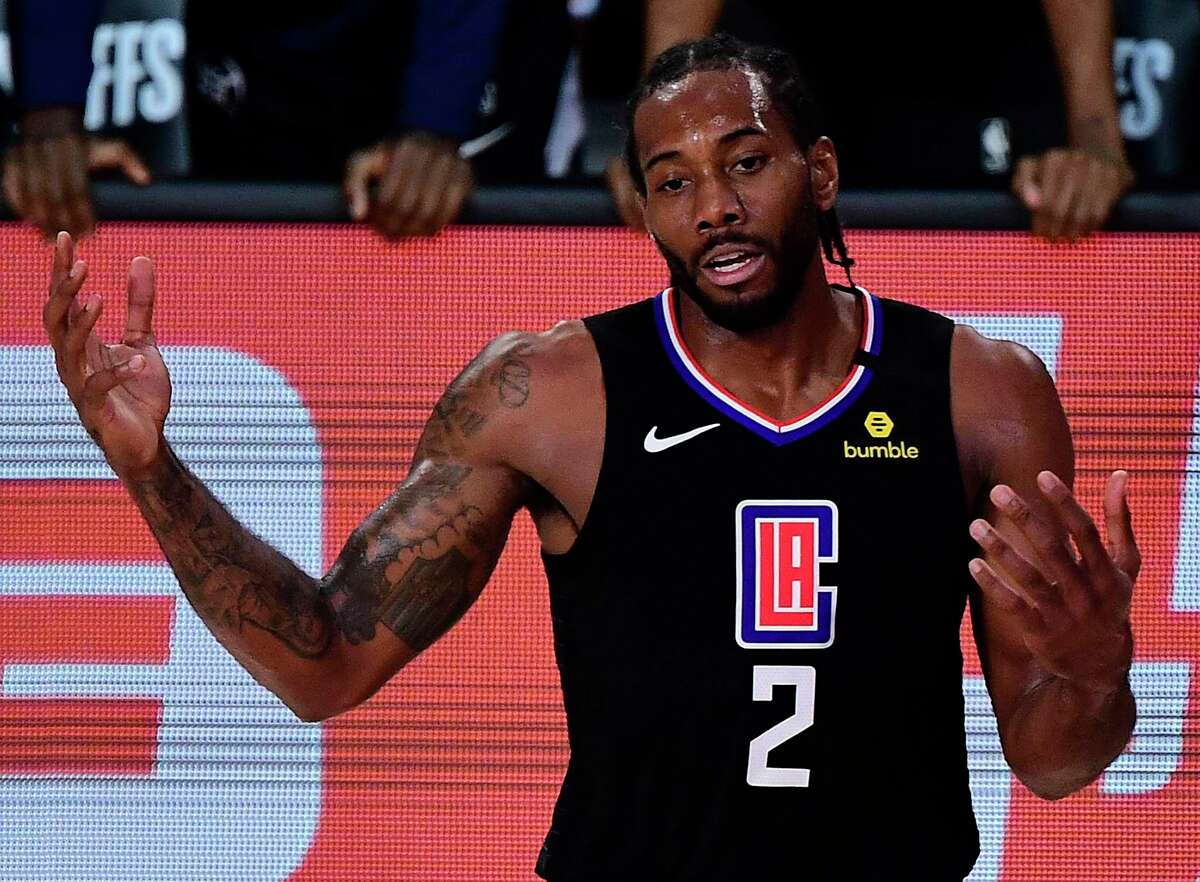 Kawhi Leonard (2) of the LA Clippers reacts during the third quarter against the Denver Nuggets in Game Seven of the Western Conference Second Round during the 2020 NBA Playoffs at AdventHealth Arena at the ESPN Wide World Of Sports Complex on September 15, 2020 in Lake Buena Vista, FL. (Douglas P. DeFelice/Getty Images/TNS)