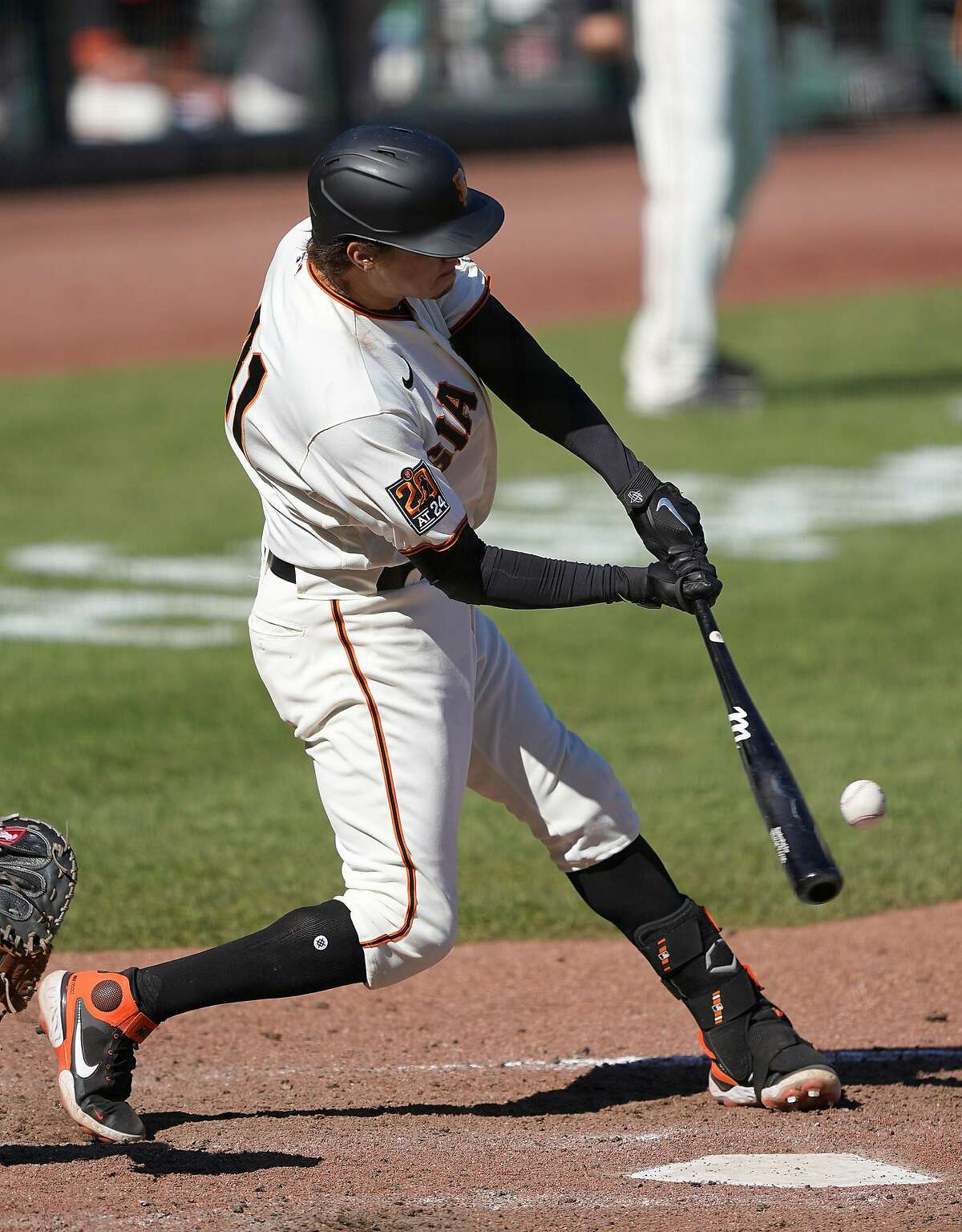 SAN FRANCISCO, CALIFORNIA - SEPTEMBER 17: Wilmer Flores #41 of the San Francisco Giants hits a two-run RBI triple against the Seattle Mariners in the top of the seventh inning at Oracle Park on September 17, 2020 in San Francisco, California. (Photo by Thearon W. Henderson/Getty Images)