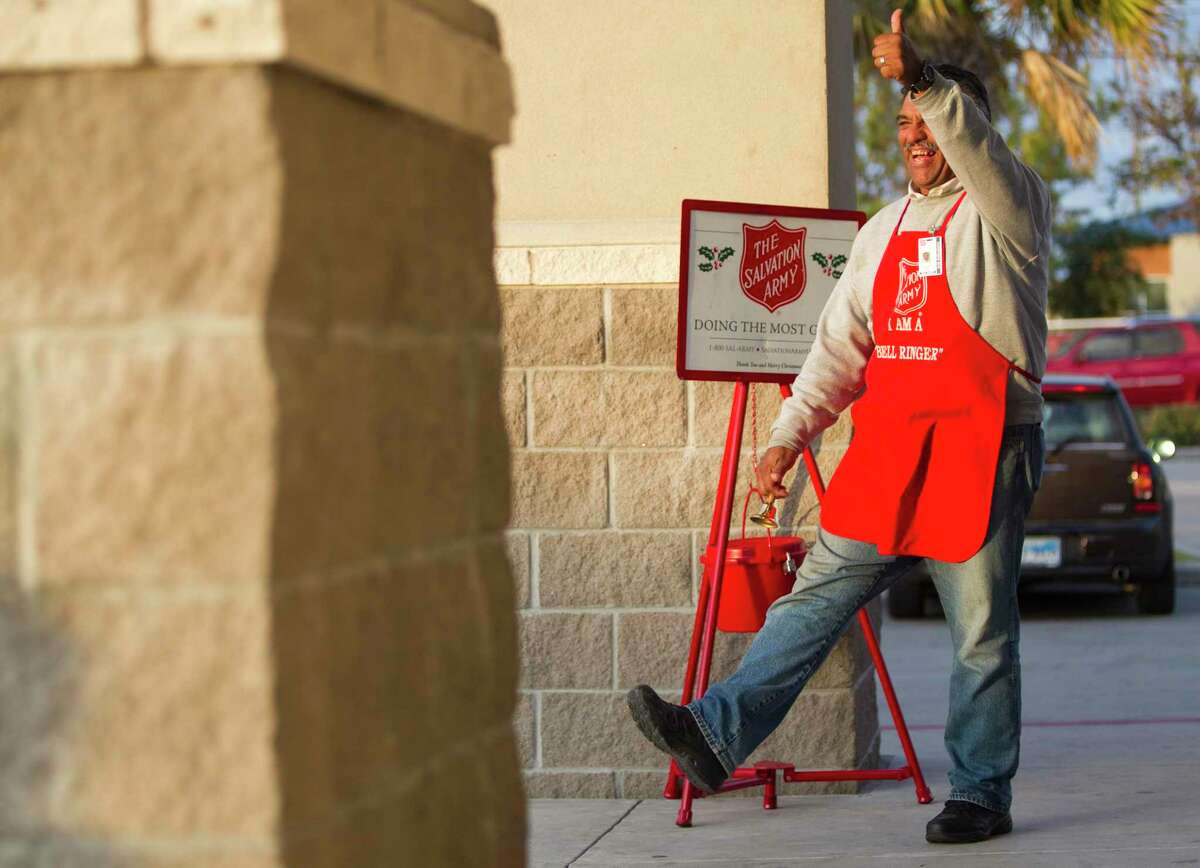 """Salvation Army Bell Ringer Earnest """"Chico"""" Duran smiles and gives a 'thumbs up"""" as he works outside the Walgreen's at Washington and Studemont Friday, Dec. 10, 2010, in Houston. It is the fourth year Duran has worked as a bell ringer for the annual holiday season fund drive."""