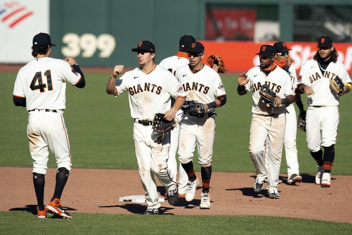 San Francisco Giants players celebrate their 6-4 victory over the Seattle Mariners in a baseball game, Thursday, Sept. 17, 2020 in San Francisco. (AP Photo/D. Ross Cameron)