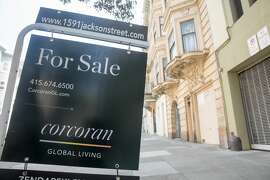 A sign for an apartment for rent hangs outside an apartment building in San Francisco, California on Sept. 16, 2020.
