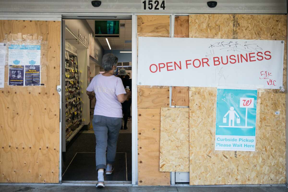 The entrance of a Walgreens is boarded up but open for business in San Francisco on Sept. 16, 2020.