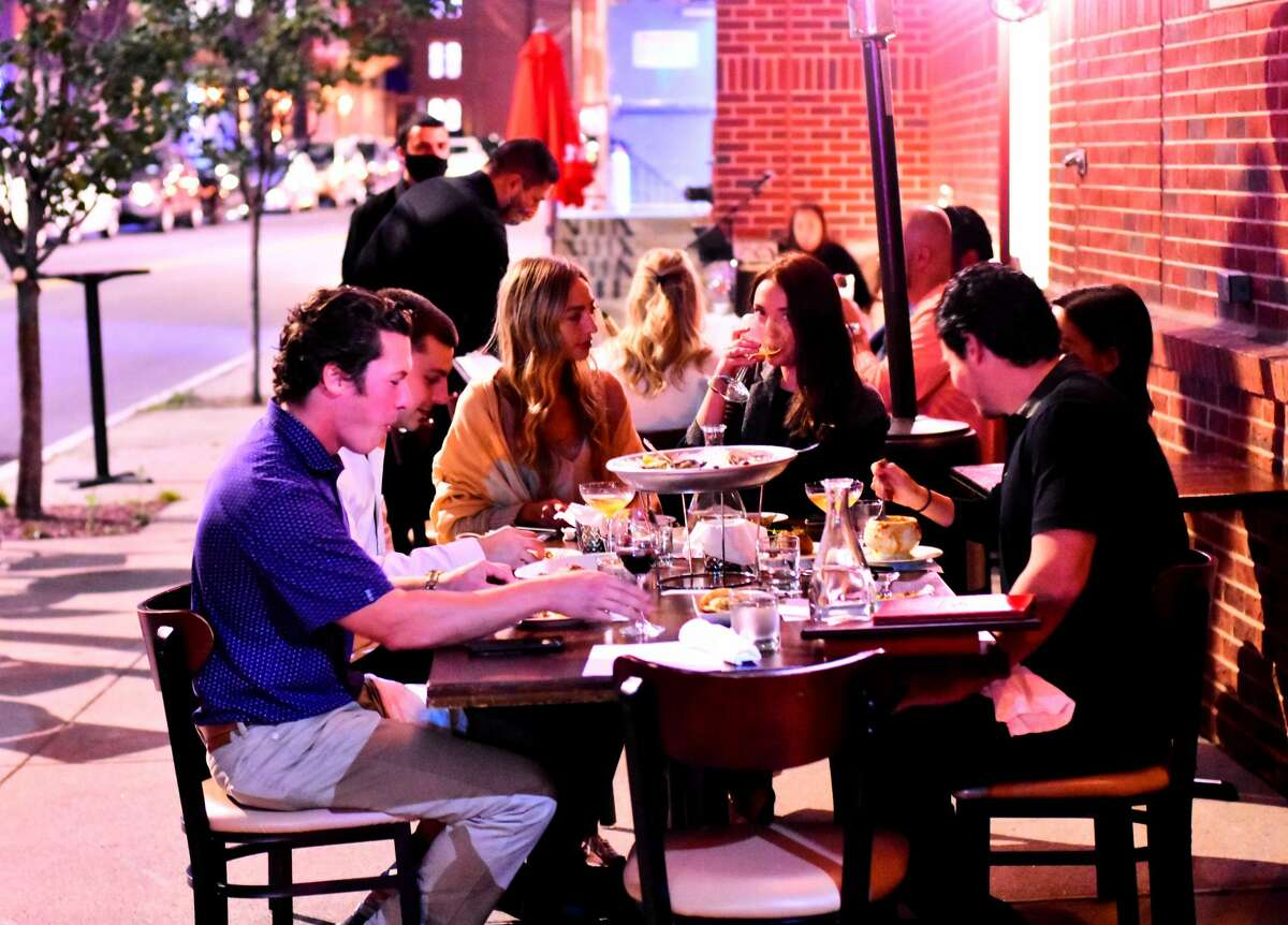 Patrons sit at sidewalk tables on Sheridan Avenue in downtown Albany alongside dp: An American Brasserie on Thursday, Sept. 17, 2020. (Steve Barnes/Times Union)