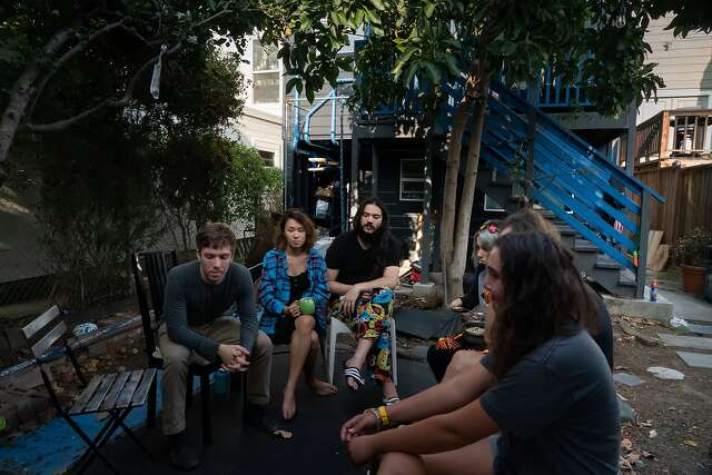 The residents of the Manor of Being hold a meeting. Eleven international people share the home with occupations that includes tech, mathematics, music and art.