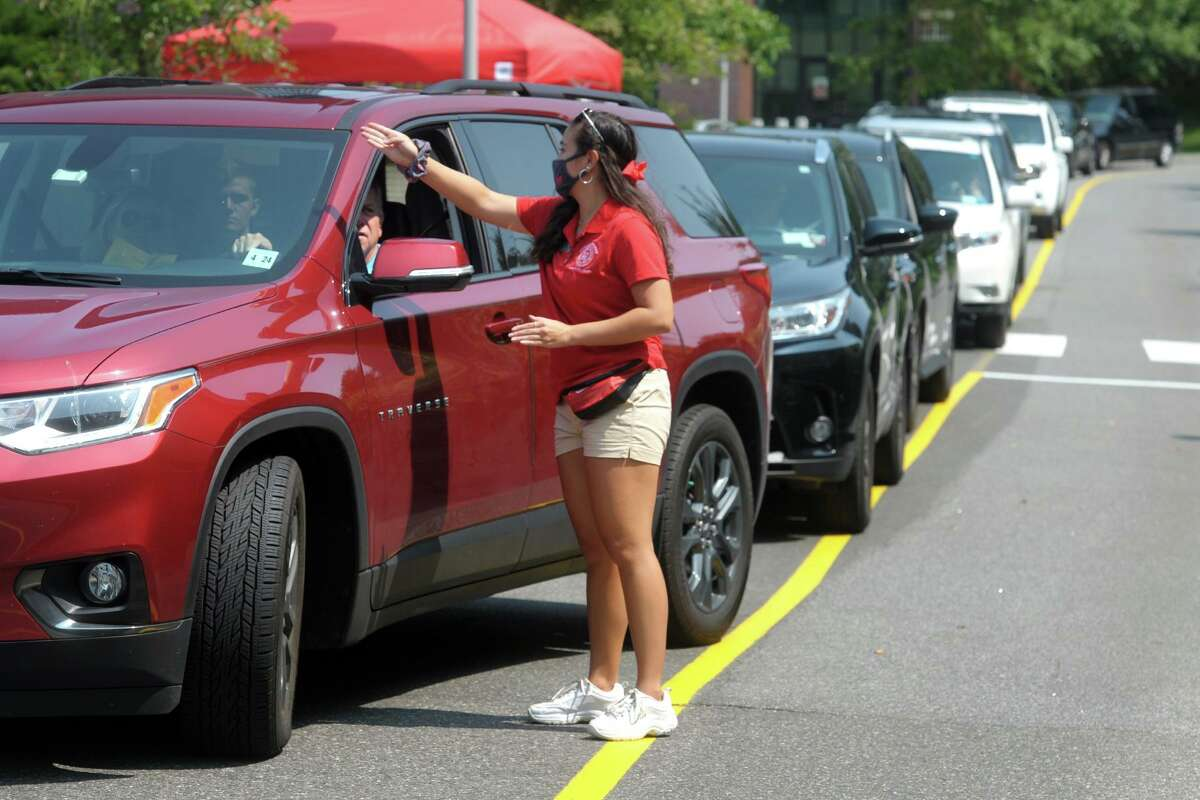 Freshmen arrive on the campus of Sacred Heart University in Fairfield Aug. 25.