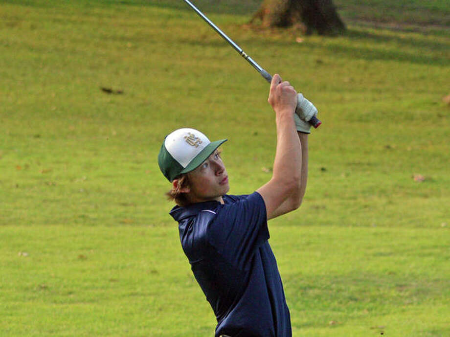 Father McGivney's Brandon Reed hits his second shot on hole No. 9 at Oak Brook Golf Club during Thursday's triangular match against Metro-East Lutheran and Roxana. Photo: Scott Marion/The Intelligencer