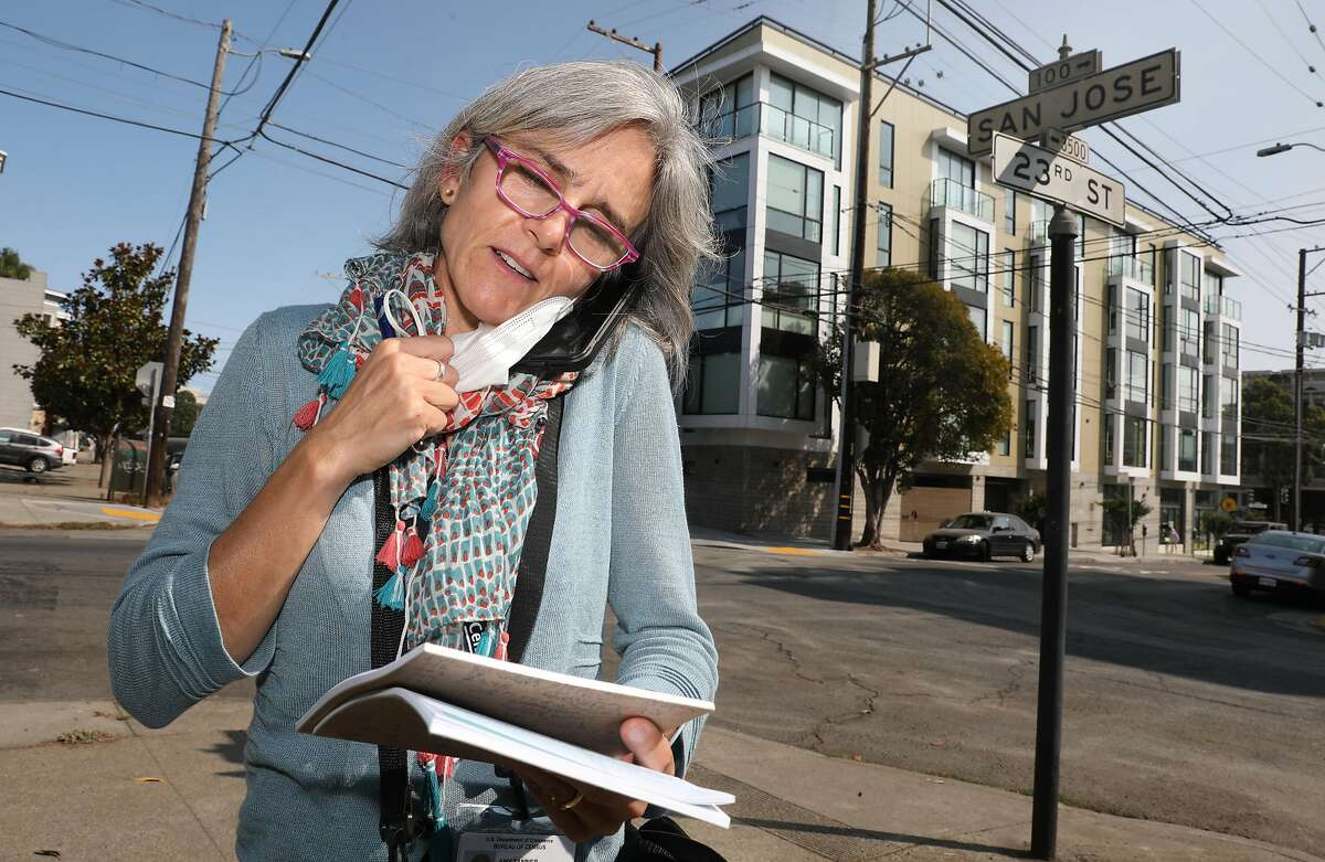 Census enumerator Amy Tanner talks to resident on the telephone to include on the census as she stands on San Jose Ave. at 23rd St. on Thursday, Sept. 17, 2020, in San Francisco, Calif.