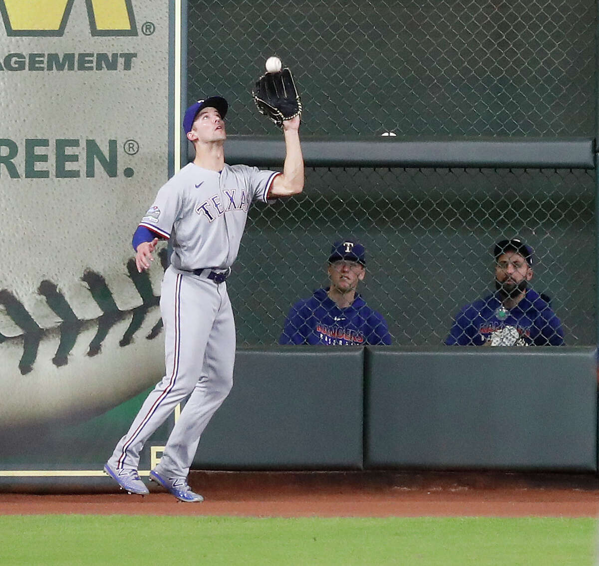 Texas Rangers left fielder Eli White catches Houston Astros Yuli Gurriel's fly out during the seventh inning of an MLB baseball game at Minute Maid Park, Thursday, September 17, 2020, in Houston.
