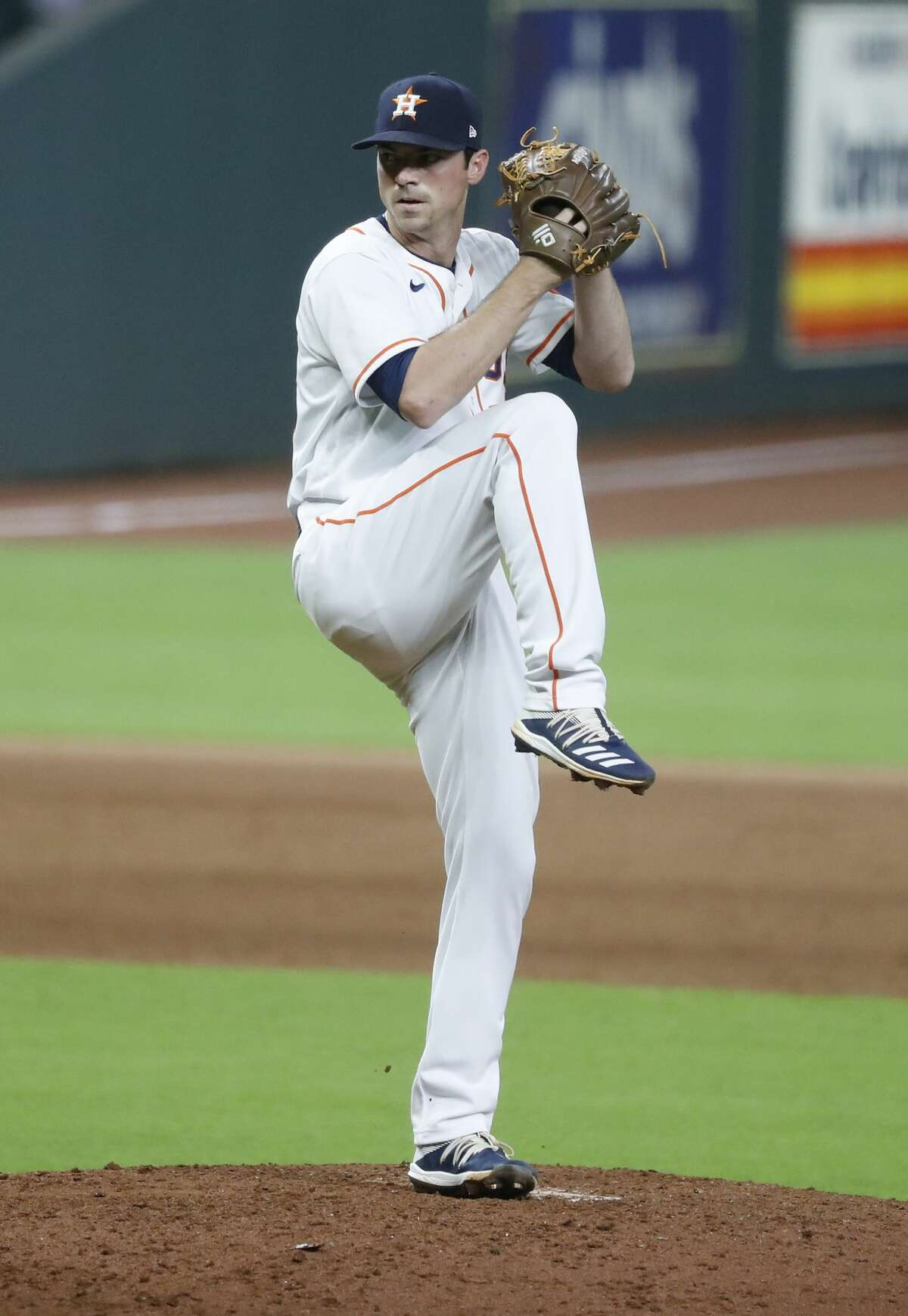 Houston Astros relief pitcher Brooks Raley (58) closes out the game against Texas Rangers during the ninth inning of an MLB baseball game at Minute Maid Park, Thursday, September 17, 2020, in Houston. Astros won 2-1.