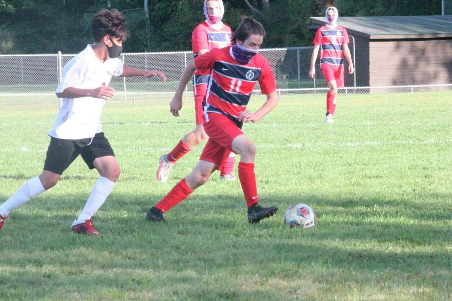 Big Rapids' Seth Shantz (11) works with the ball against Kent City in Thursday soccer action. (Pioneer photo/John Raffel)