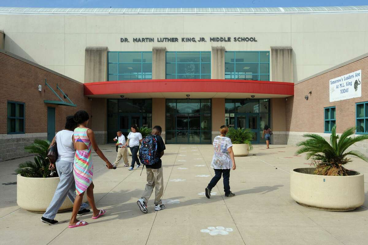 Several parents walked their children to he first day of classes at Martin Luther King Junior High in Beaumont on Monday. Monday marked the first day that Austin Middle School students merged with MLK. Photo taken Monday, August 25, 2014 Guiseppe Barranco/@spotnewsshooter