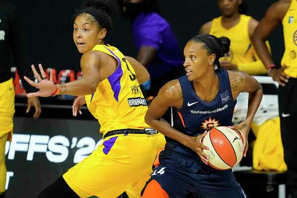 Connecticut Sun forward DeWanna Bonner, right, looks to pass around Los Angeles Sparks forward Candace Parker during the first half of a WNBA playoff basketball game on Thursday in Bradenton, Fla. Bonner had 17 points and 13 rebounds in the Sun's 73-57 win.