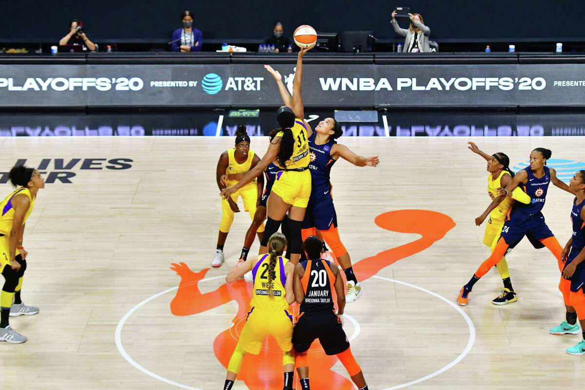 Kristine Anigwe (31) of the Los Angeles Sparks and Brionna Jones (42) of the Connecticut Sun tip off their second round playoff game at Feld Entertainment Center on Thursday in Palmetto, Fla. The Sun won 73-57.