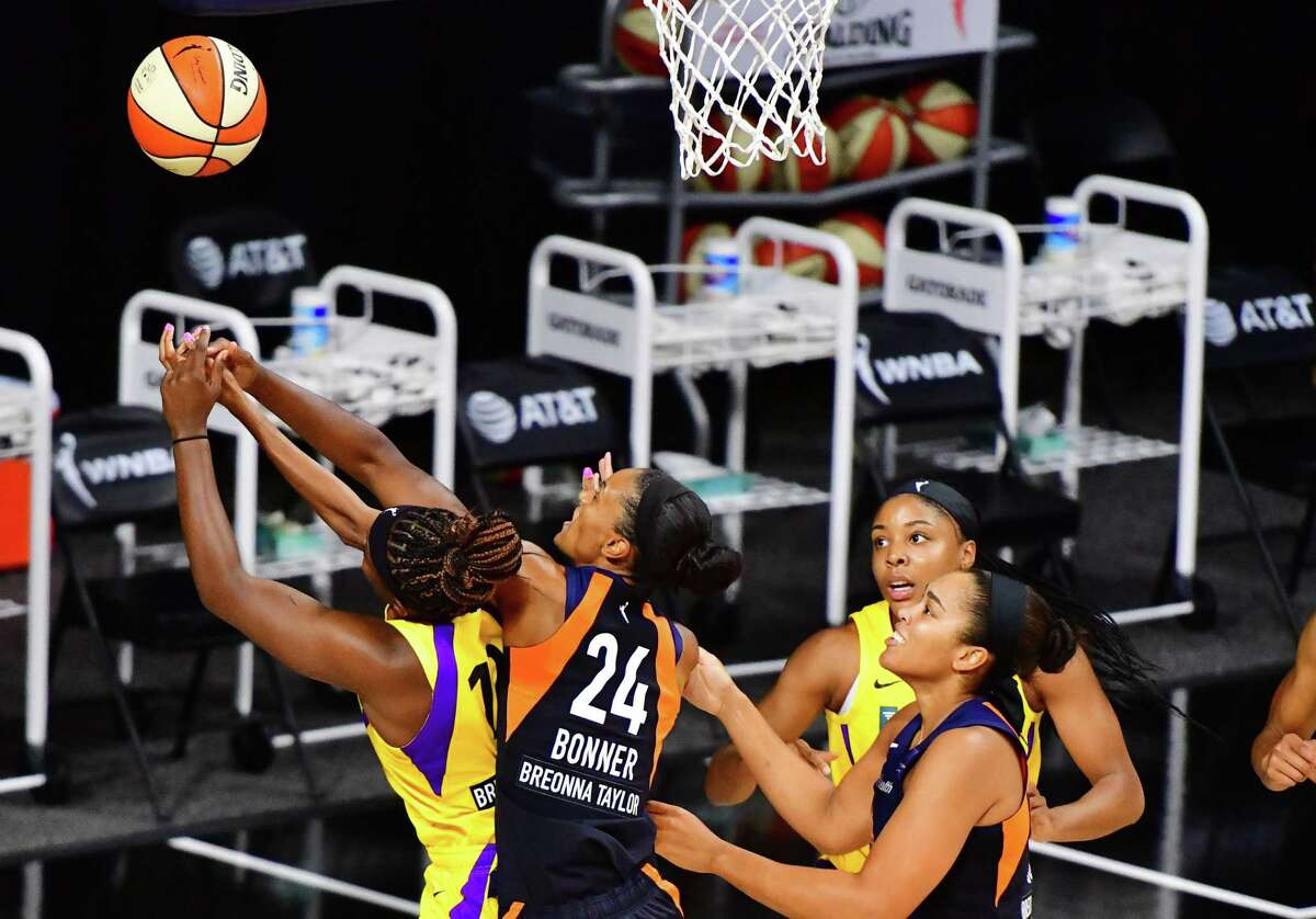 DeWanna Bonner (24) of the Connecticut Sun fouls Chelsea Gray (12) of the Los Angeles Sparks in the first half of their second round playoff game at Feld Entertainment Center on Thursday in Palmetto, Fla. The Sun won 73-57.