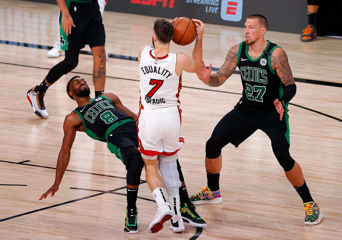 LAKE BUENA VISTA, FLORIDA - SEPTEMBER 17: Goran Dragic #7 of the Miami Heat drives the ball against Kemba Walker #8 of the Boston Celtics and Daniel Theis #27 of the Boston Celtics during the fourth quarter in Game Two of the Eastern Conference Finals during the 2020 NBA Playoffs at AdventHealth Arena at the ESPN Wide World Of Sports Complex on September 17, 2020 in Lake Buena Vista, Florida. NOTE TO USER: User expressly acknowledges and agrees that, by downloading and or using this photograph, User is consenting to the terms and conditions of the Getty Images License Agreement. (Photo by Kevin C. Cox/Getty Images)