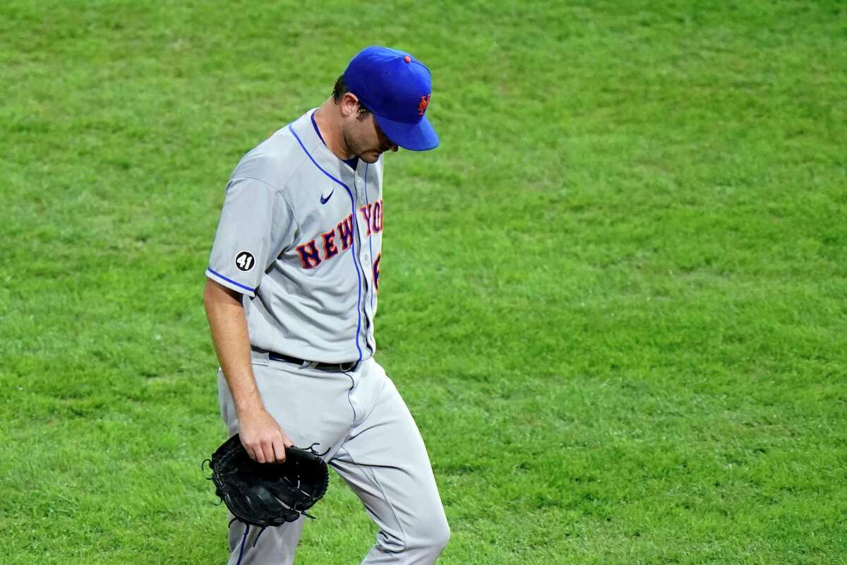 New York Mets pitcher Seth Lugo walks off the field after being pulled during the second inning of a baseball game against the Philadelphia Phillies, Thursday, Sept. 17, 2020, in Philadelphia. (AP Photo/Matt Slocum)