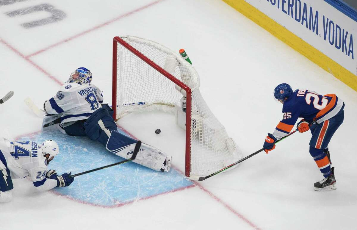 New York Islanders defenseman Devon Toews (25) scores on Tampa Bay Lightning goaltender Andrei Vasilevskiy (88) during the first period of Game 6 of the NHL hockey Eastern Conference final, Thursday, Sept. 17, 2020, in Edmonton, Alberta. (Jason Franson/The Canadian Press via AP)