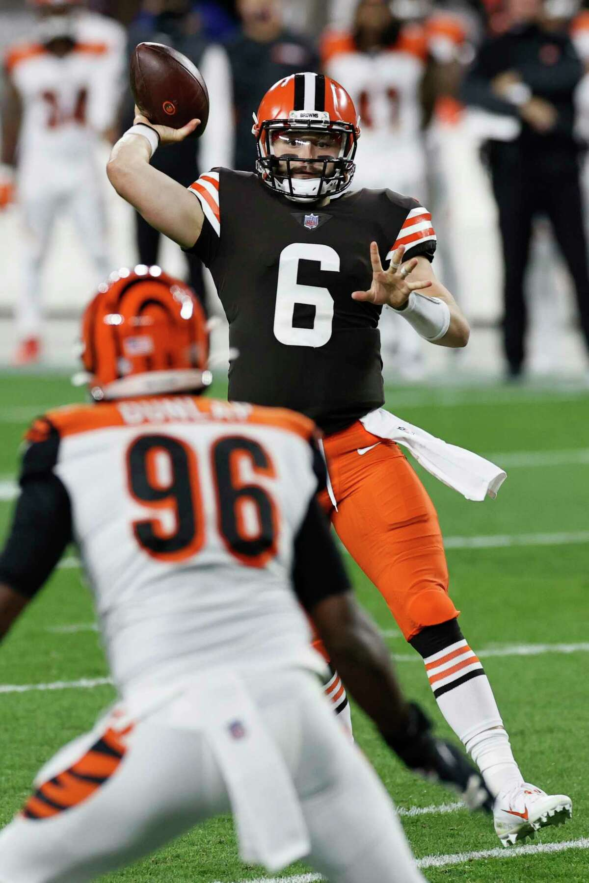 Cleveland Browns quarterback Baker Mayfield throws a 6-yard touchdown pass to running back Kareem Hunt during the first half of the team's NFL football game against the Cincinnati Bengals, Thursday, Sept. 17, 2020, in Cleveland. (AP Photo/Ron Schwane)