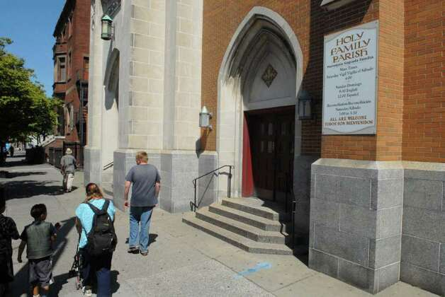Parishioners arrive for service at the Church of the Holy Family on Central Avenue in Albany on Sunday, Aug. 29, 2010.  The Roman Catholic Diocese of Albany announced Sunday that it has removed deacon  Angel Garcia from active ministry at the church after determining there were reasonable grounds to believe he sexually abused a minor in the early 1990s prior to his training and ordination as a?deacon. (Paul Buckowski / Times Union) Photo: Paul Buckowski