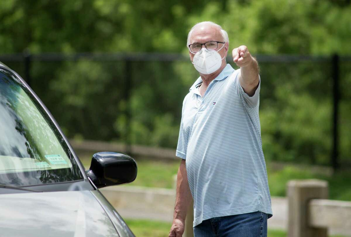 First Selectman Rudy Marconi is a believer in mask-wearing, but he can't see the town enforcing $100 fines on people out in public without masks.
