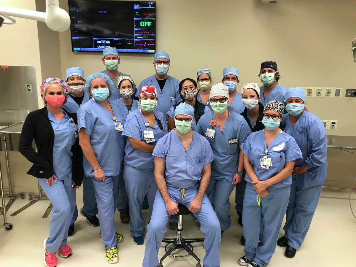 The Houston Methodist West transcatheter aortic valve replacement team celebrate after performing two successful surgeries on Sept. 14, 2020.